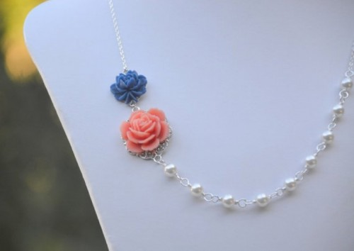 a chic pearl bridal or bridesmaid necklace with a coral and a navy bloom