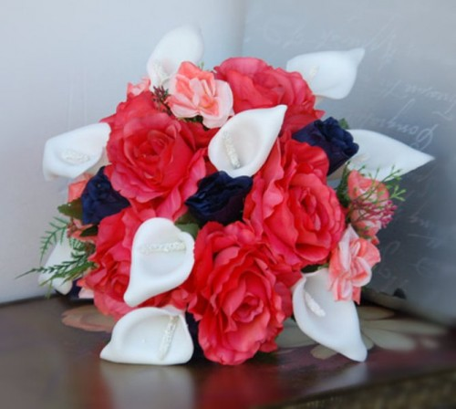 a bold wedding bouquet with white calla lilies, navy and coral pink blooms and touches of greenery