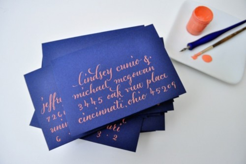 navy and coral wedding cards look super bold and unusual, such a bright combo
