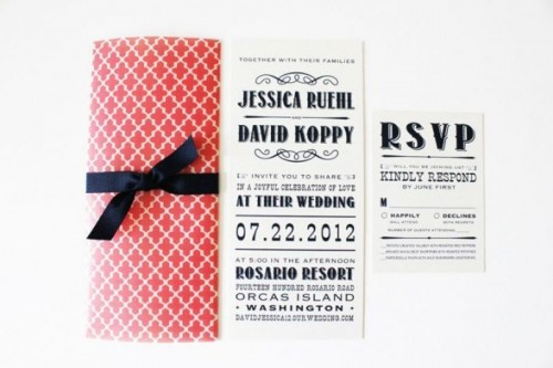 an elegant navy, coral and white wedding invitation suite with a bow and bold lettering