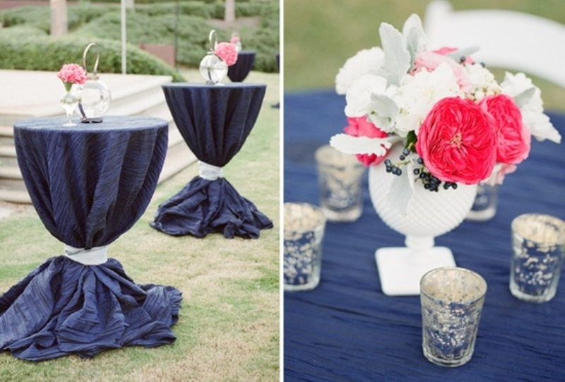 cocktail tables with navy tablecloths and bright coral and white blooms will highlight your color scheme
