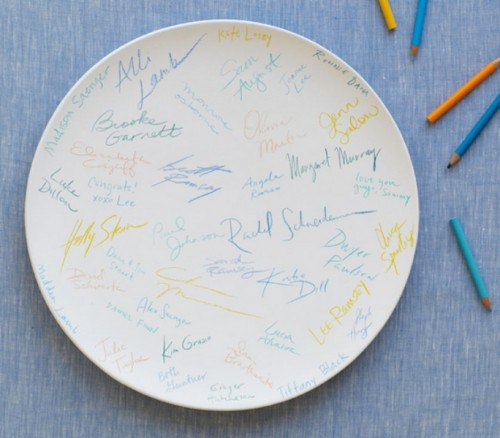 a large white ddish or your ring dish can become a nice guest book with colorful signatures and wishes