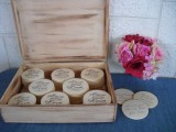 a wooden box with wooden circles, on which the guests will write their wishes and monograms