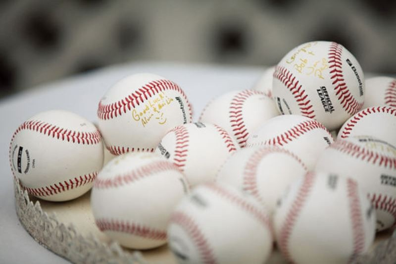 if you love baseball or play it, offer your guests baseball balls to sign them up