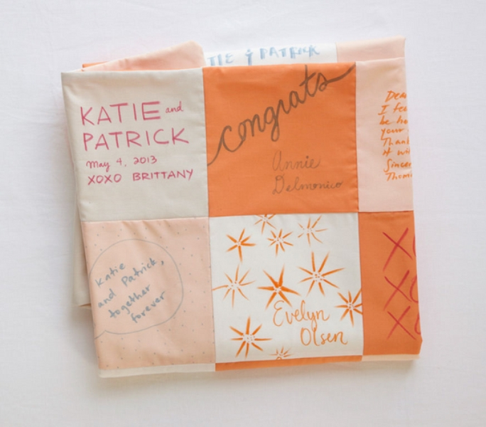 a patchwork blanket that can be DIYed   each patch is signed by a guest   it's a very bold and unique idea