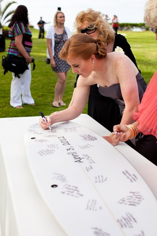 a surf as a guest book is a cool idea for a surfers' or beach wedding, or if you two are into this sport