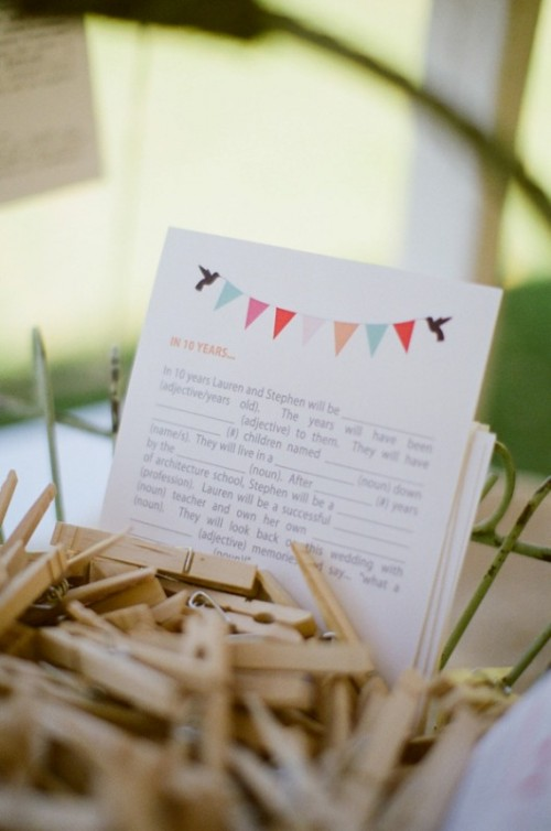 wooden clothespins as a guest book to sign your wishes right on them is a great idea