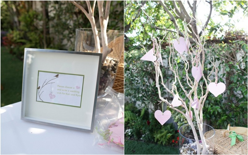 a whitewashed tree with pink hearts that are to be signed by the guests is a creative and fun idea