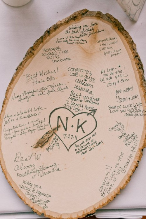 an oversized wooden slice or several ones can be easily signed by the guests and later used by you as an artwork