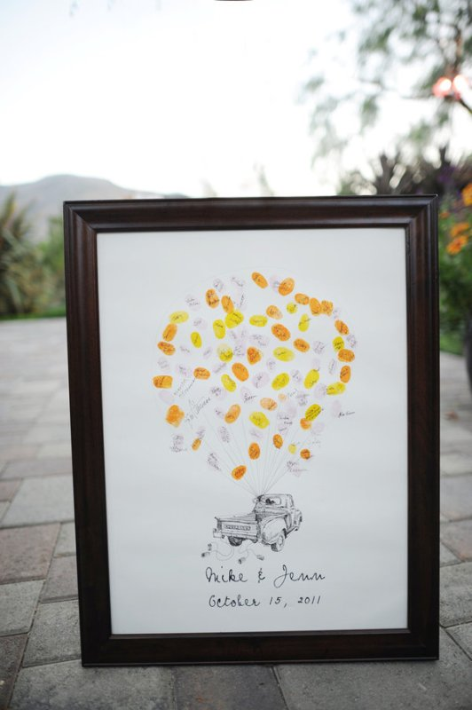 a framed artwork with a truck with colorful balloons that can be signed by the guests is a ready artwork