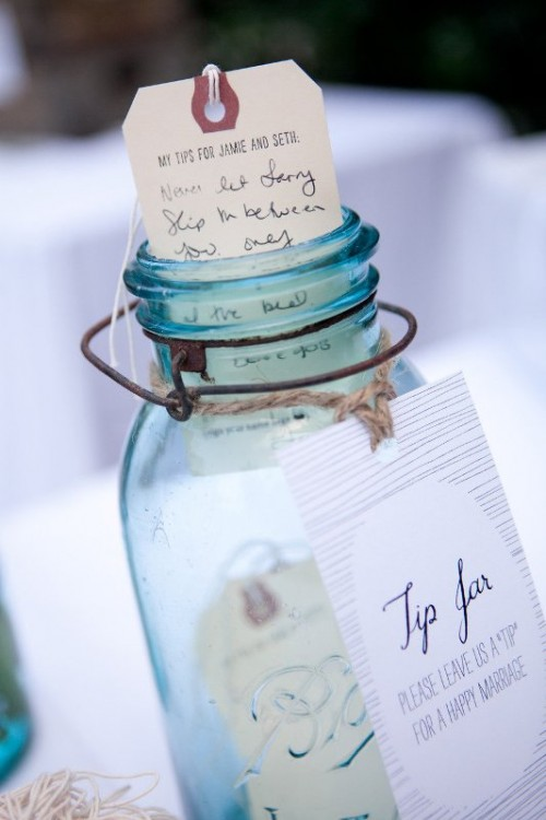 a blue jar with tags that contain wishes from the guests is a simple and very cute idea