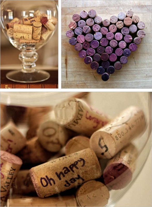 a large glas sor jar filled with wine corks   each guest signs up each cork and voila