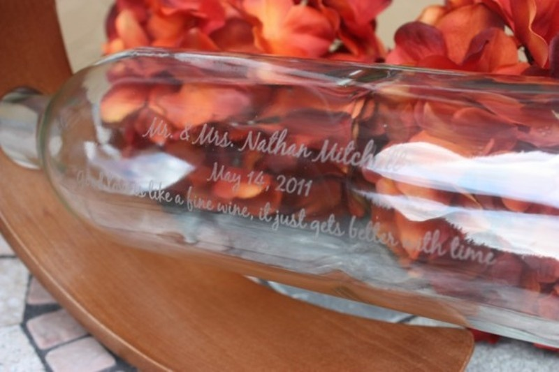 a bottle with your names and dates can accommodate many papers with wishes and signs