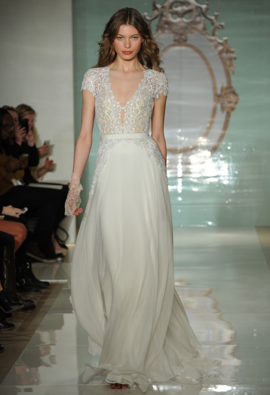 an A line wedding dress with a lace bodice and short sleeves, a plain skirt with a train looks modern and fresh