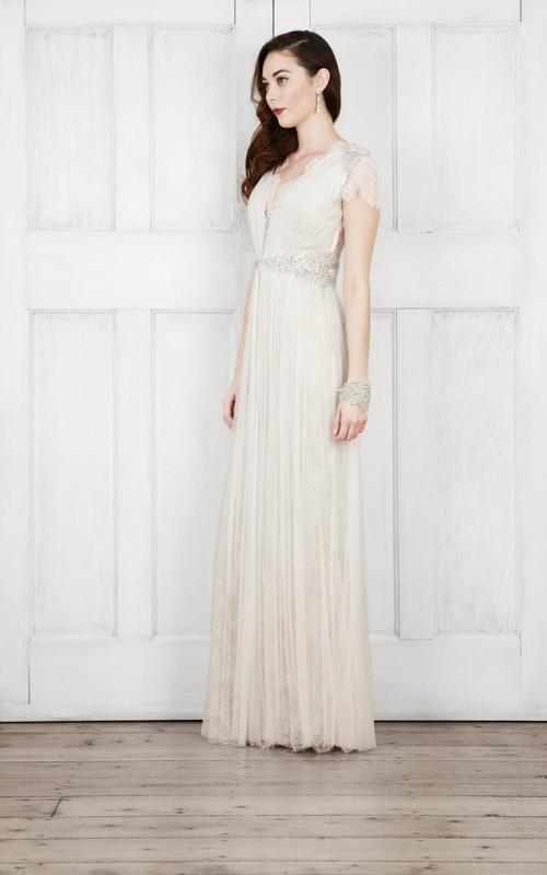 a romantic art deco fully draped wedding dress with lace short sleeves, a deep neckline, an embellished sash and a matching bracelet