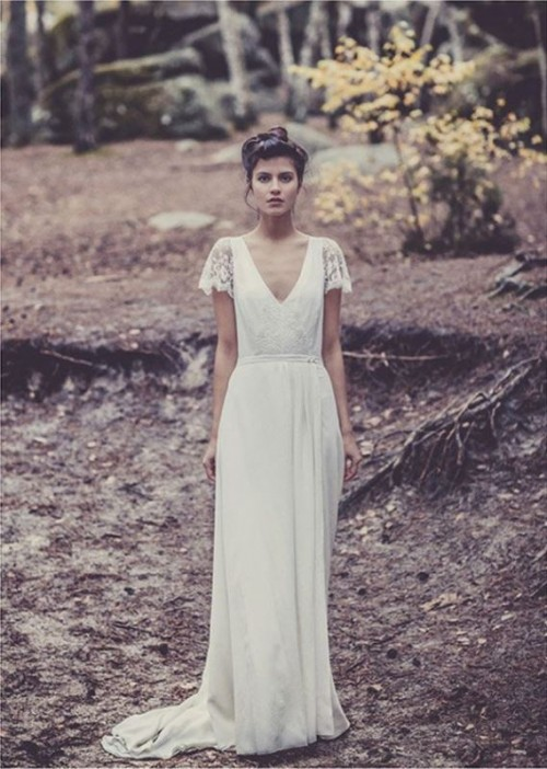 a cool A-line lace wedding dress with a deep V-neckline, lace short sleeves and a short train