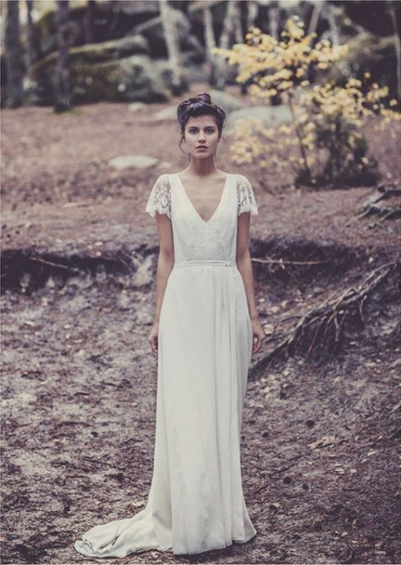 a cool A line lace wedding dress with a deep V neckline, lace short sleeves and a short train