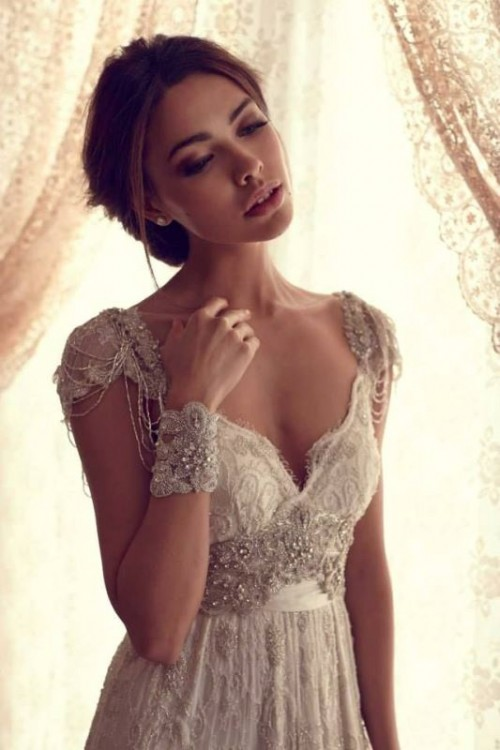 a fully embellished lace wedding dress with cap sleeves, a deep neckline for a bride who wants to sparkle all over