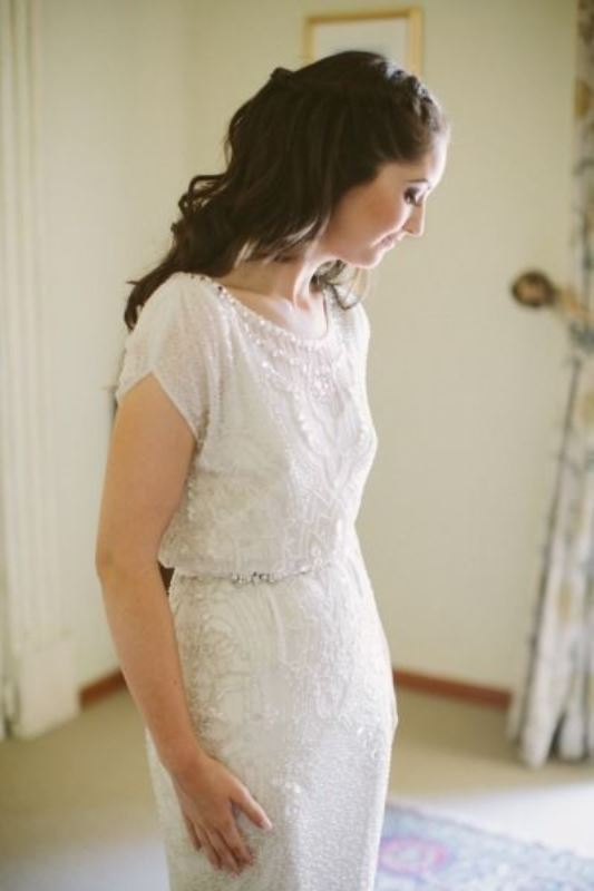 an embellished and embroidered fitting wedding dress with short sleeves, an illusion neckline looks refined and really chic