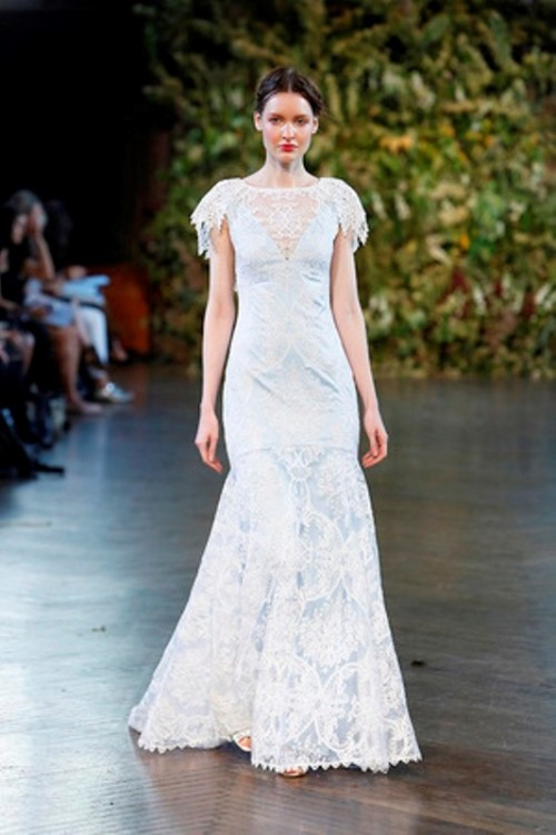 a fitting lace wedding dress with a lace illusion neckline, short embellished sleeves and a train