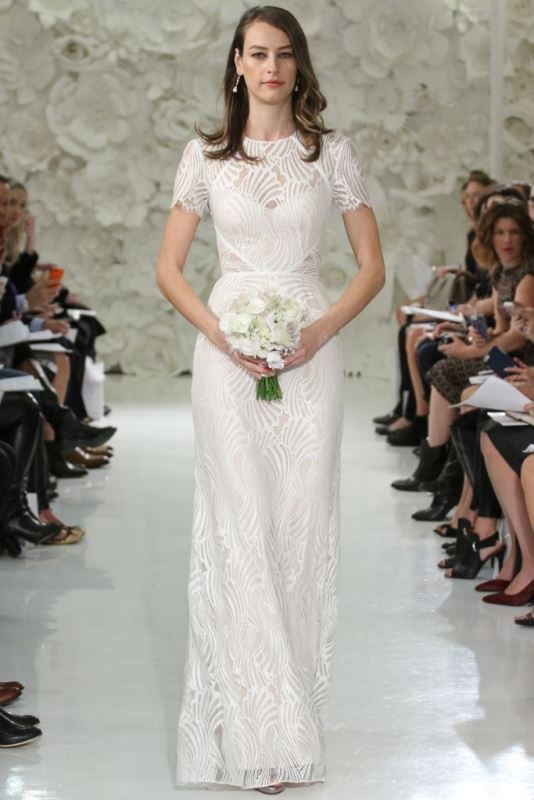 a fitting lace wedding dress with short sleeves and a high illusion neckline for a modern bride