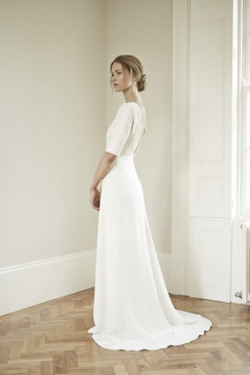 a modern plain A-line wedding dress with short sleeves, a high neckline, a cutout back and a small train