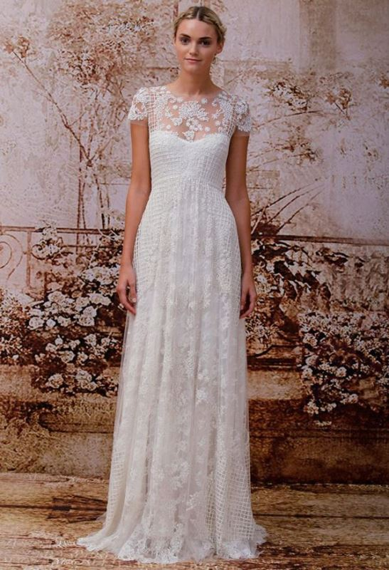 a lace A line wedding dress with an illusion neckline, short sleeves, a small train for a modern romantic bride