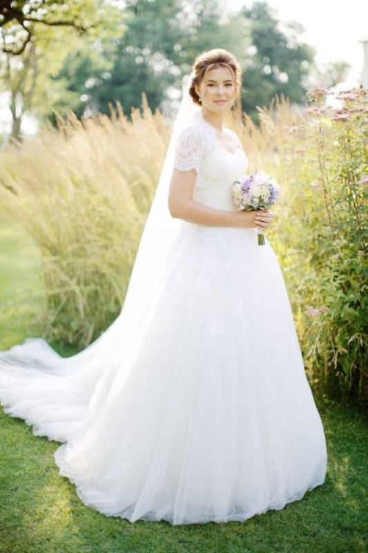 a lace wedding ballgown with short sleeves, a V neckline and a train is a gorgeous idea for a formal wedding