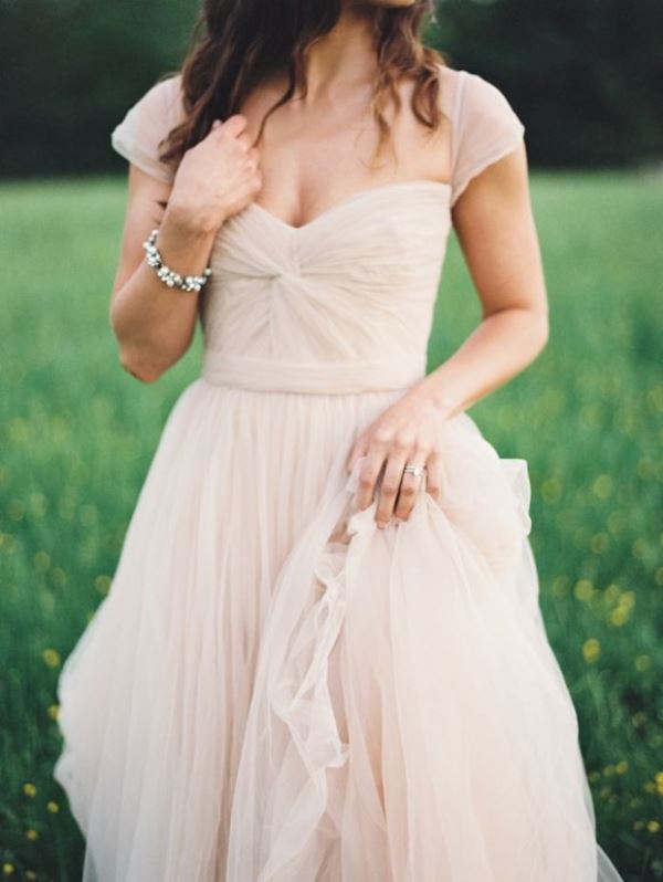 a nude a line wedding dress with short sleeves, a V neckline and a draped bodice is a modern take on classics