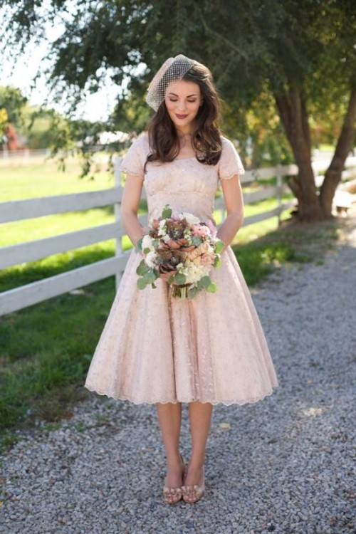 a blush midi floral A-line wedding dress with embellishments and matching shoes plus a birdcage veil