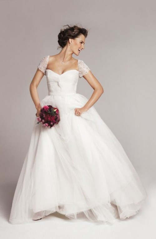 an A-line wedding dress with a sweetheart neckline, embellished short sleeves is gorgeous