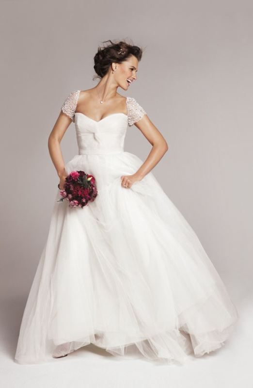 an A line wedding dress with a sweetheart neckline, embellished short sleeves is gorgeous