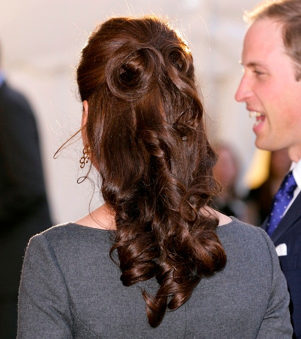 a refined half updo with a volume on top, curls, waves down is an elegant and chic idea