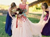 a bold blush and red floral embroidery wedding ballgown with a high neckline and no sleeves is a chic idea to try