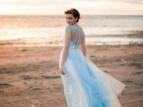 a blue lace wedding dress with a blue trail and bold blue shoes is a cool and chic idea for your 'something blue'