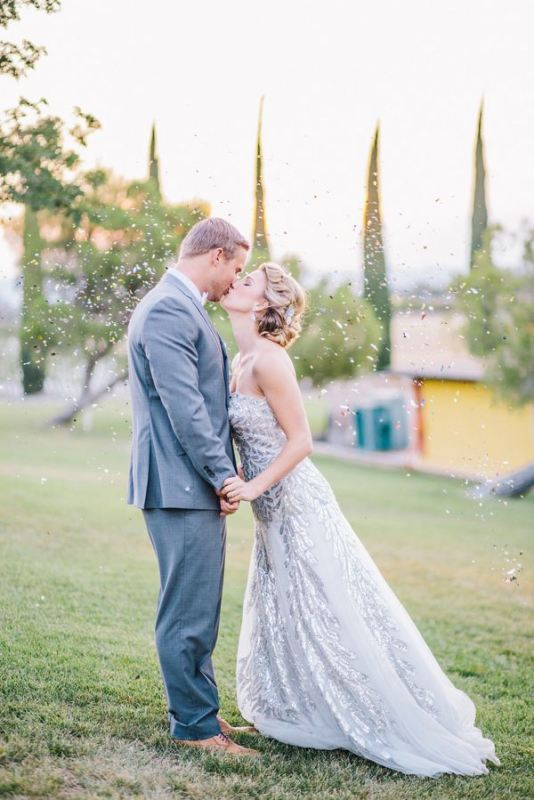 a romantic grey sequinned strapless wedding dress with a train is a non traditional option for a color loving bride