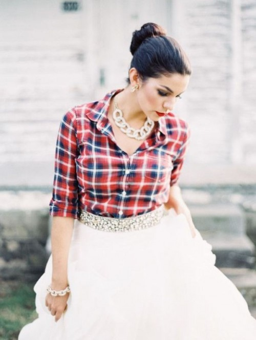 a plaid shirt, a tutu skirt with an embellished sash, a statement chain necklace for a rustic bridal look
