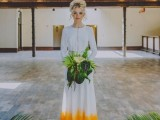 a non-traditional wedding dress in white, with lace inserts and a yellow edge of the skirt for a colorful statement