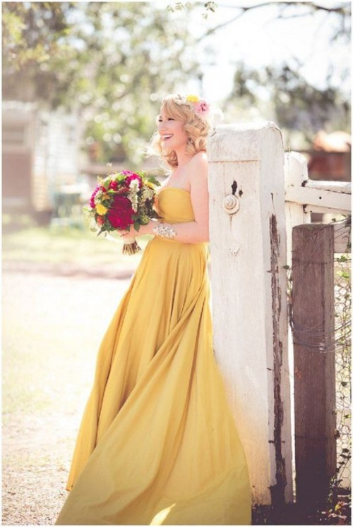 a sunshine yellow strapless A-line wedding dress paired with statement accessories is very bold