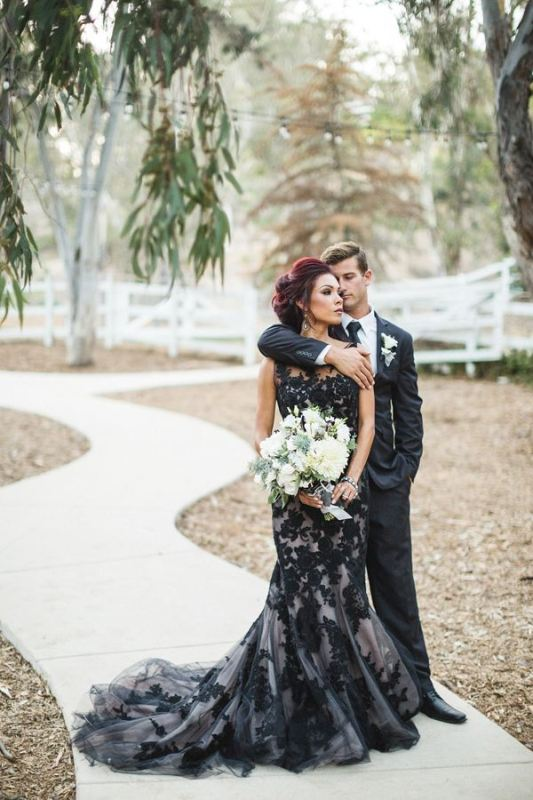 a refined black and white floral lace mermaid wedding dress with no sleeves and an illusion neckline is romantic
