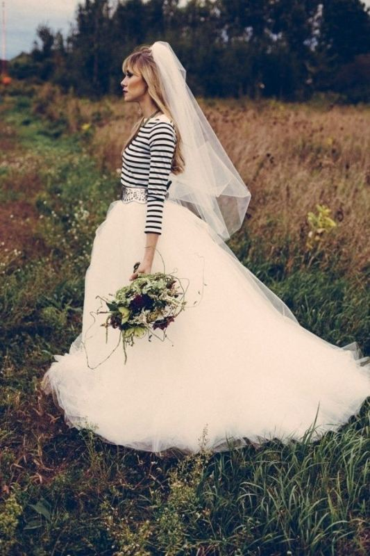 a striped top, a full tutu skirt with a train and a veil for an out of the box bridal look