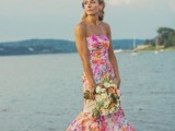 a colorful strapless mermaid wedding dress with bright splashes of various shades is bold and cool