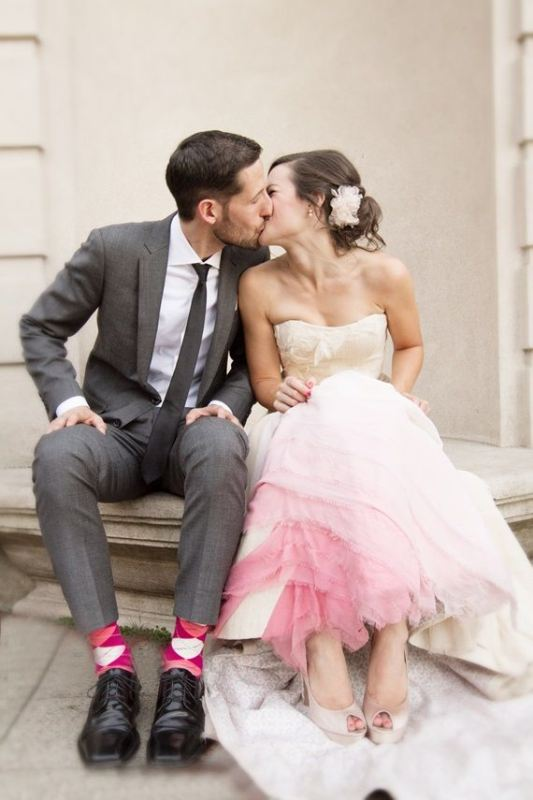 a strapless textural wedding ballgown with a pink skirt is a girlish statement with color