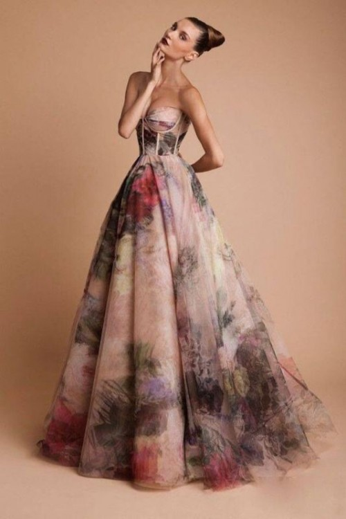a strapless dark floral wedding ballgown with a bustier bodice and a train for a strong wow factor
