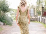 a gold sequin sheath wedding dress with cap sleeves and an open back is a shiny glam idea to rock