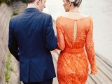 an orange sheath wedding dress with long sleeves, a cutout back and lace appliques is a statement with color