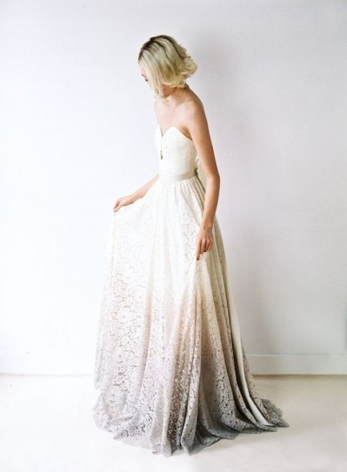 an ombre strapless lace wedding dress with an embellished sash for a romantic and subtle look
