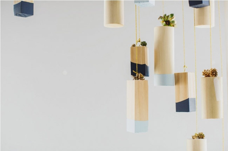 hanging color block vases with light and midnight blue touches and small succulents for venue decor
