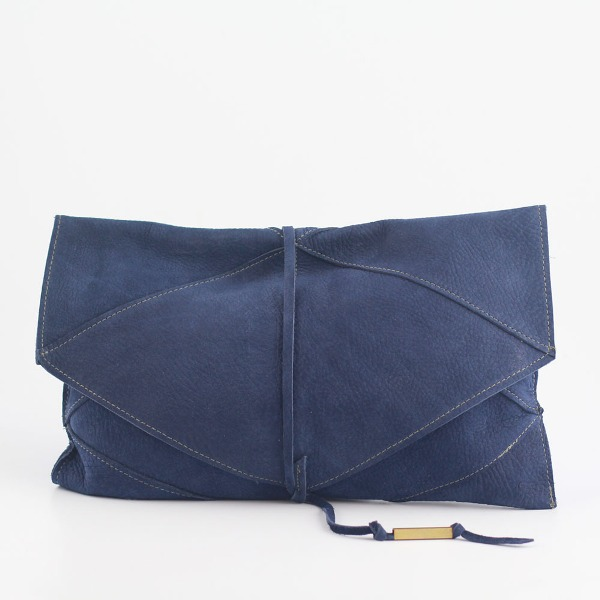 a cool midnight blue leather clutch will hold everything a bride needs on her big day