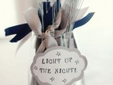 a jar with sparklers and white and blue ties for your wedding exit